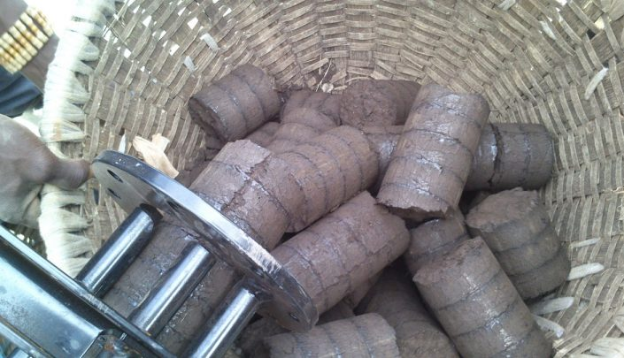 Finished briquettes exiting the cooling line